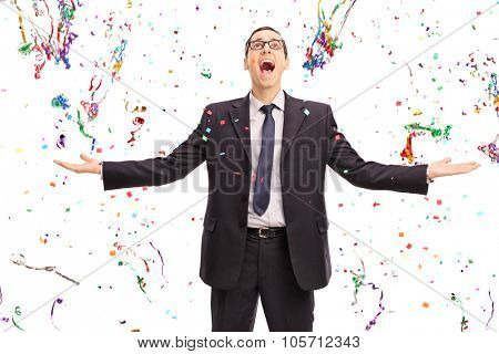 Studio shot of an overjoyed businessman standing in the middle of a lot of confetti streamers isolated on white background poster