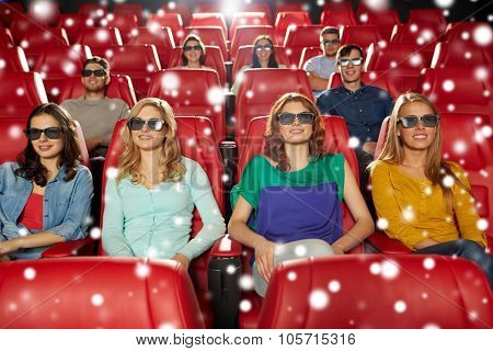 cinema, technology, entertainment and people concept - happy friends with 3d glasses watching movie in theater over snowflakes