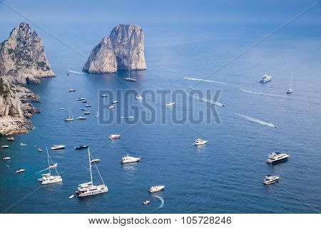 Capri island Italy. Coastal landscape with Faraglioni rocks and pleasure yachts poster
