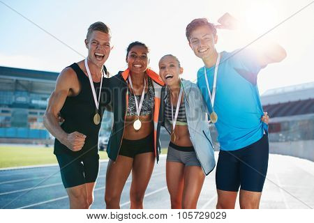Team Of Athletes Enjoying Victory