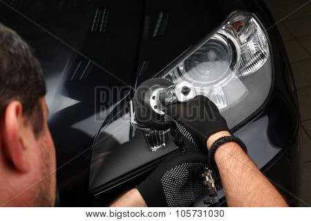 Car Service. Polishing Of Optics Of The Car 2