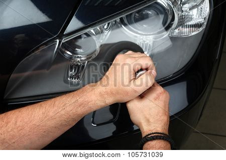 Car Service. Polishing Of Optics Of The Car 4