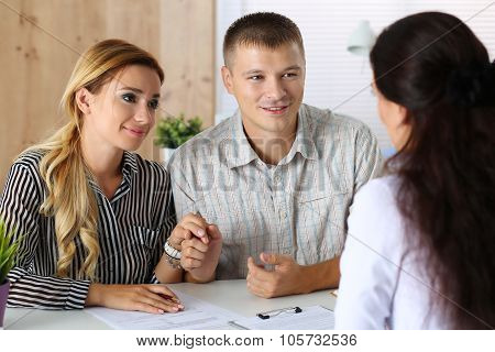 Young Family Couple Trying To Get Loan