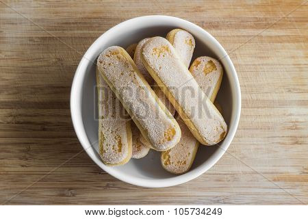Ladyfingers in a bowl, top view