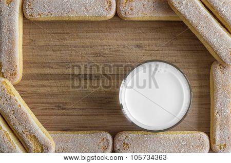 Ladyfinger biscuits with milk, food frame