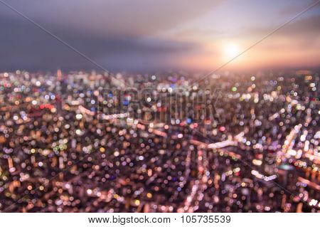Aerial bokeh of Tokyo skyline from above during sunset and blue hour - Japanese world famous capital with spectacular nightscape panorama - Violet marsala filter on blurred defocused night lights poster
