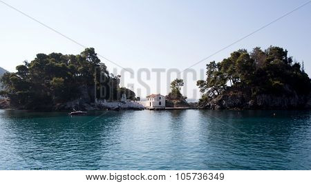 Church on small island Parga Greece seascape background