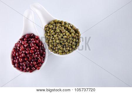 bowl adzuki and mung beans isolated on white