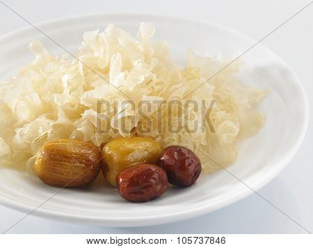 jujubes (Chinese red dates), and white wood ear fungus (also snow fungus or silver tree ear fungus). Eaten as Chinese medicine. poster