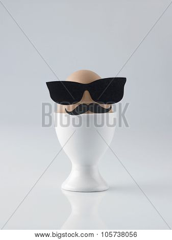 eastereggs with sunglasses are on white background