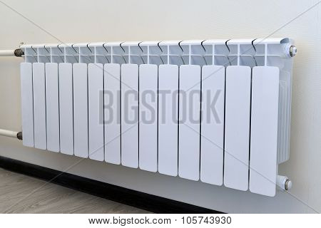 White heating radiator on the wall
