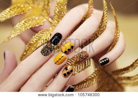 Yellow black manicure .