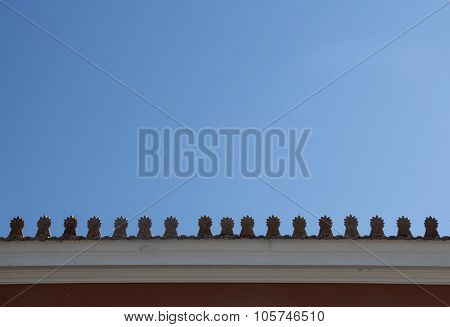 Rooftop with Akrokeramo ceramic decorative antefix and clear blue sky ** Note: Visible grain at 100%, best at smaller sizes