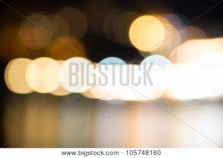 Dark abstruct background with round glowing colorful bokeh