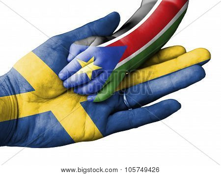 Adult Man Holding A Baby Hand With Sweden And South Sudan Flags Overlaid. Isolated On White