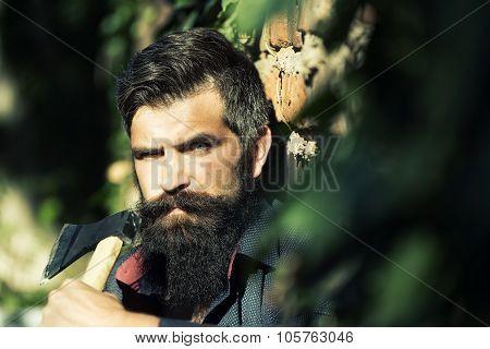 Man Holding Ax Near Wall