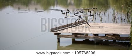 Fishing Rods On Wooden Piers