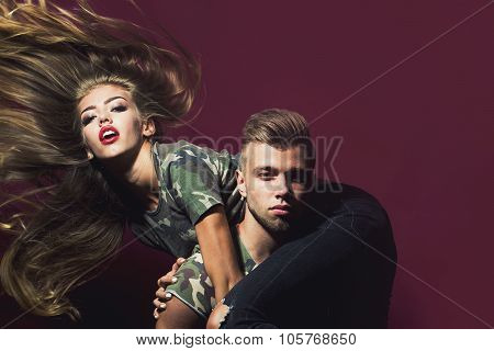 Handsome Man Hold On Shoulders Blonde Woman