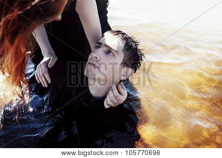 Sinking in the problems. Young man experiencing  pain and disappointment