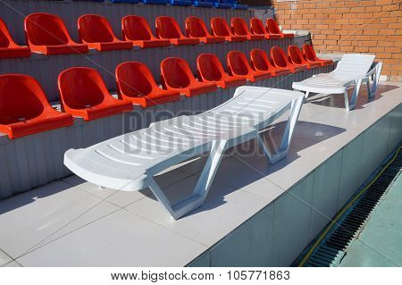 Chaise Lounge In The Swimming Pool