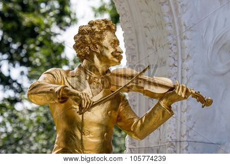 the johann strauss monument stands in the vienna city park.