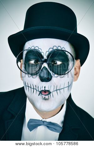 portrait of a man with mexican calaveras makeup, wearing jacket, bow tie, top hat and eyeglasses, squinting