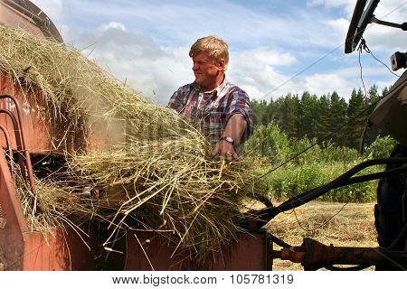 Hay Harvest, Tractor Harvesting Hay Baler, Farmer Repair Used Farm Equipment.