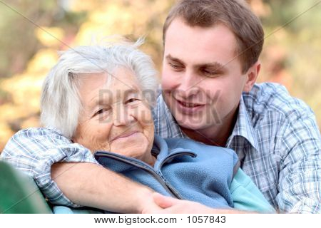 Elderly Person With Grandson
