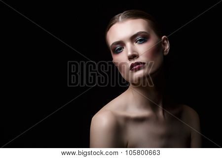 Model with bright make languidly looking at camera