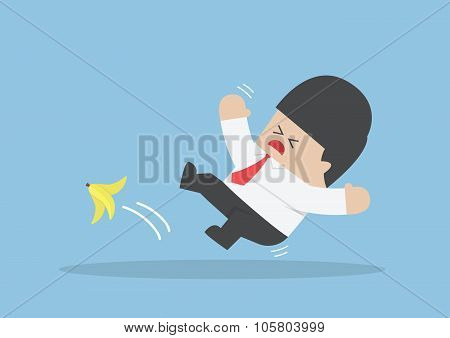 Businessman Slipping On A Banana Peel