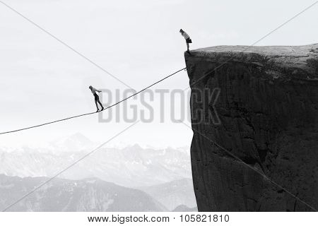 Businesswoman Walking On The Rope Over The Gap