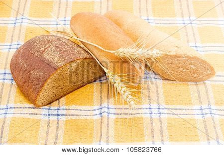 Different Types Of Bread And Spikes On A Checkered Tablecloth