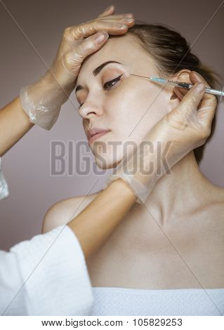 Young Pretty Woman Getting Cosmetic Injection In The Face Like A Part Of The Clinic Treatment