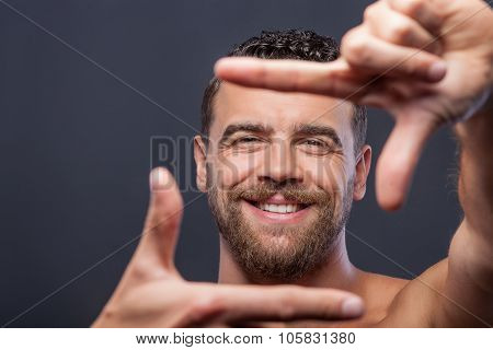 Cute guy with beard is gesturing positively
