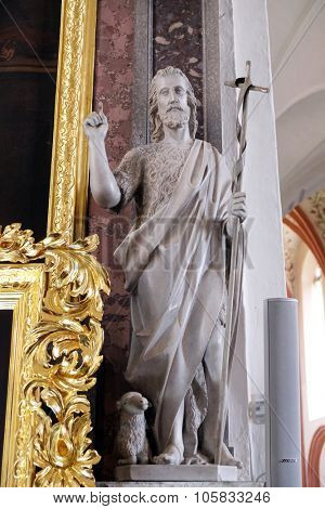NOVO MESTO, SLOVENIA - JUNE 30: Saint John the Baptist, statue on altar in Cathedral of St Nicholas in Novo Mesto, Slovenia on June 30, 2015