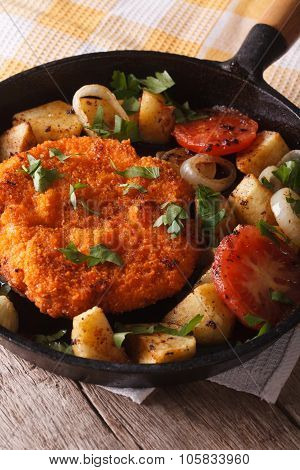 German Weiner Schnitzel With Fried Vegetables In A Pan Closeup. Vertical