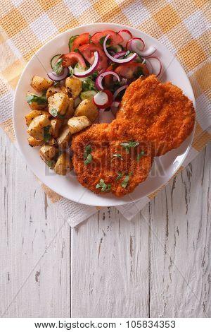 Breaded German Weiner Schnitzel With Potatoes. Vertical Top View