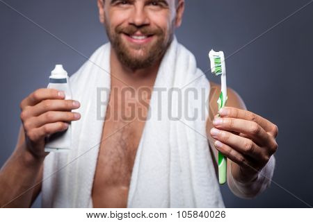 Handsome bearded guy is preparing for date
