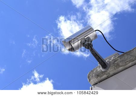 Surveillance Camera and surveillance on a sky background poster