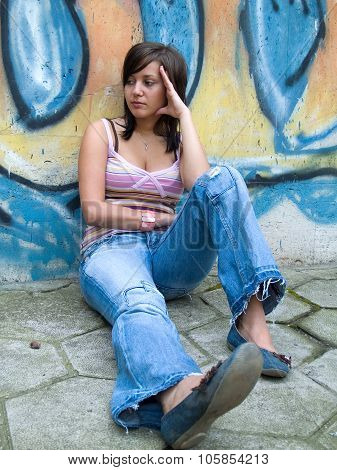 Teen In Front Of Grafitti Wall
