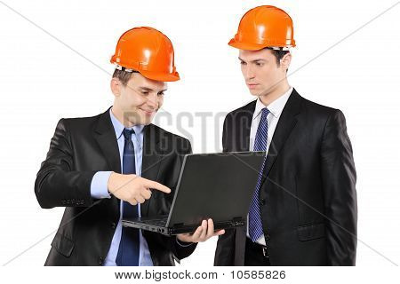 Two Foremen Looking At Laptop