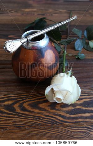 Calabash with white rose  on the wooden table