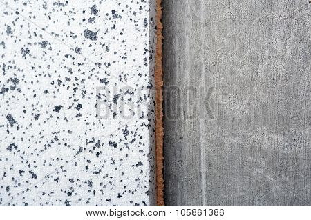 Polyurethane insulation foam between polystyrene foam concrete wall. Foam black and white background. poster