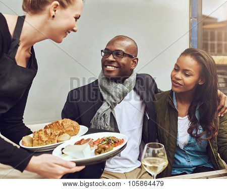 Romantic Couple Being Served Dinner
