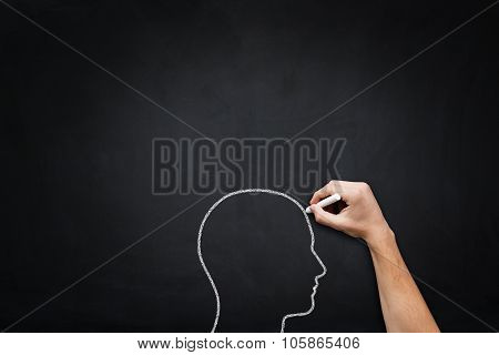 Human Head Drawing On Blackboard