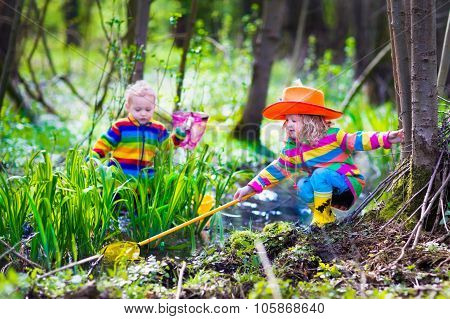 Children Playing Outdoors Catching Frog