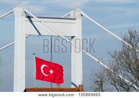 Turkish Flag With The Fatih Sultan Mehmet Bridge in Istanbul Turkey poster