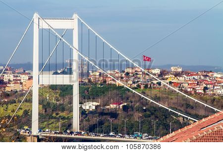 The second Bosphorus Bridge; The Fatih Sultan Mehmet in Istanbul Turkey with Turkish flag poster