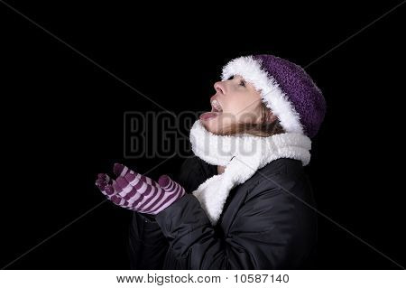 Snowing On Young Woman In Winter Clothes
