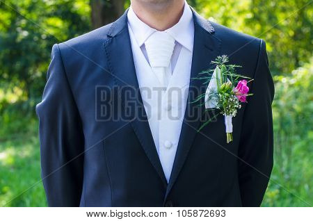 Bridge groom in suit with wonderful flower and tie